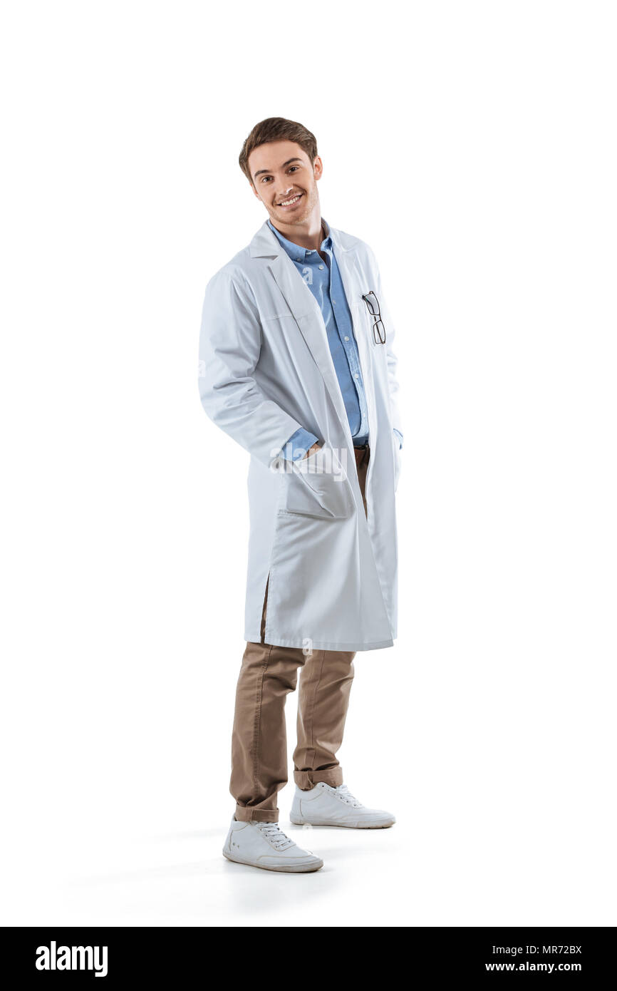 cheerful young male chemist in white coat, isolated on white - Stock Image