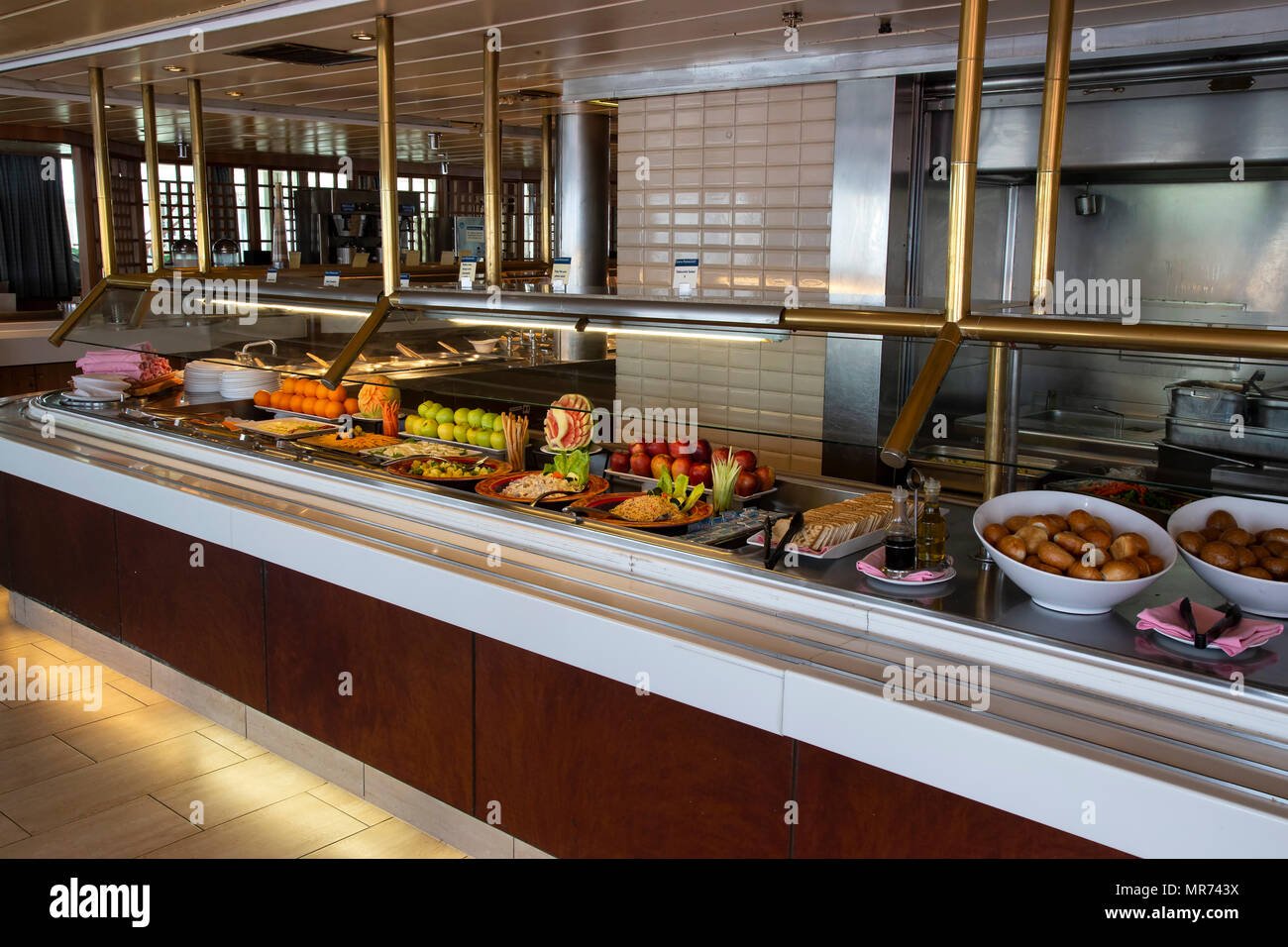 Self service food counter on cruise liner showing assortment of food - Stock Image