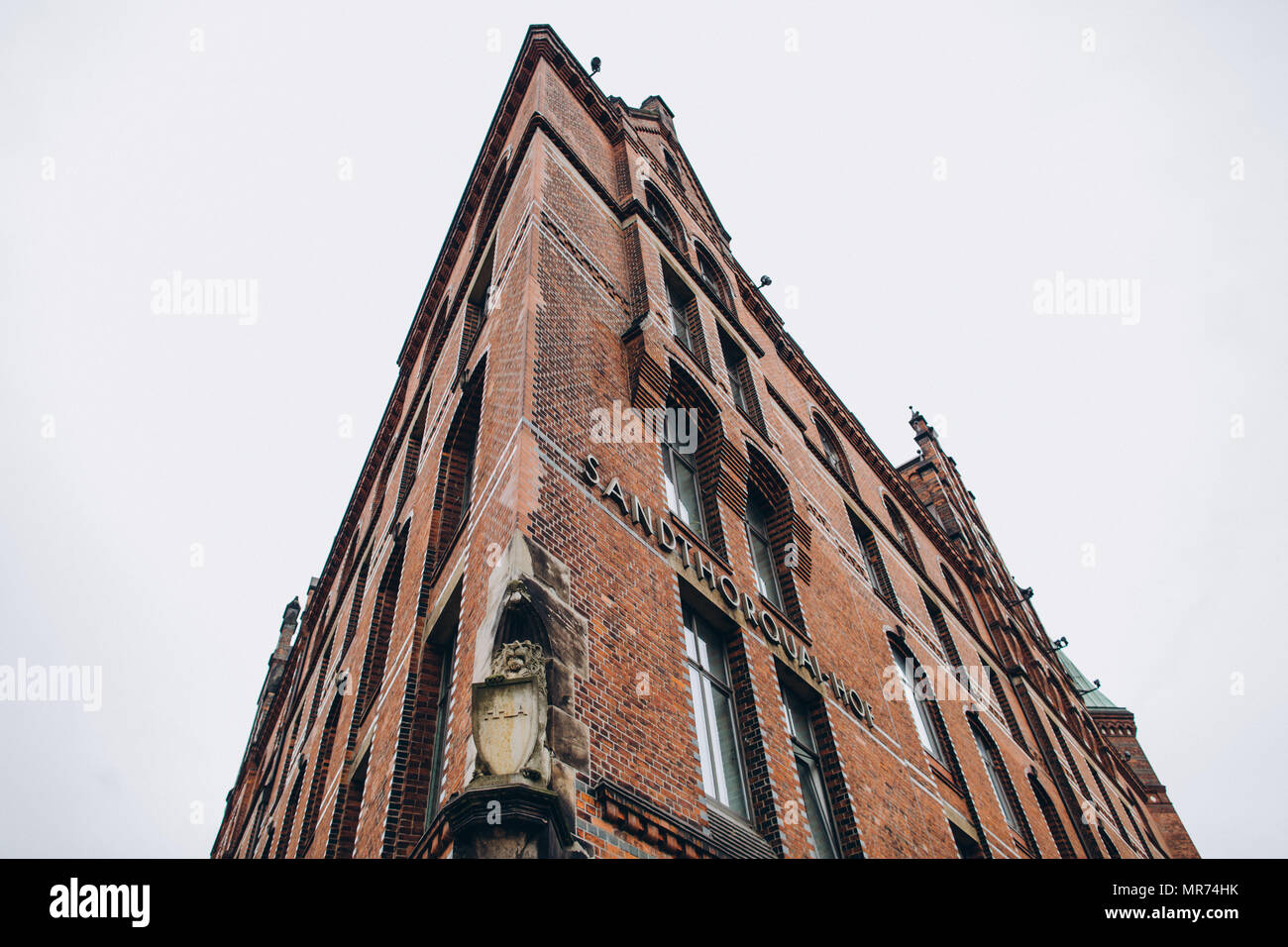 HAMBURG, GERMANY - SEP 4, 2016: low angle view of Sandthorquaihof in the Speicherstadt district, Hamburg, Germany, Europe Stock Photo