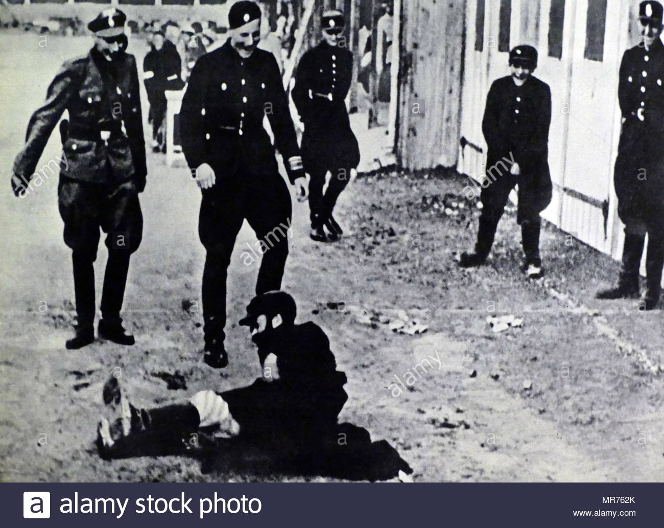 Nazi Police and soldiers attack a Jewish man in Gdansk, Poland after the German occupation of 1939 - Stock Image