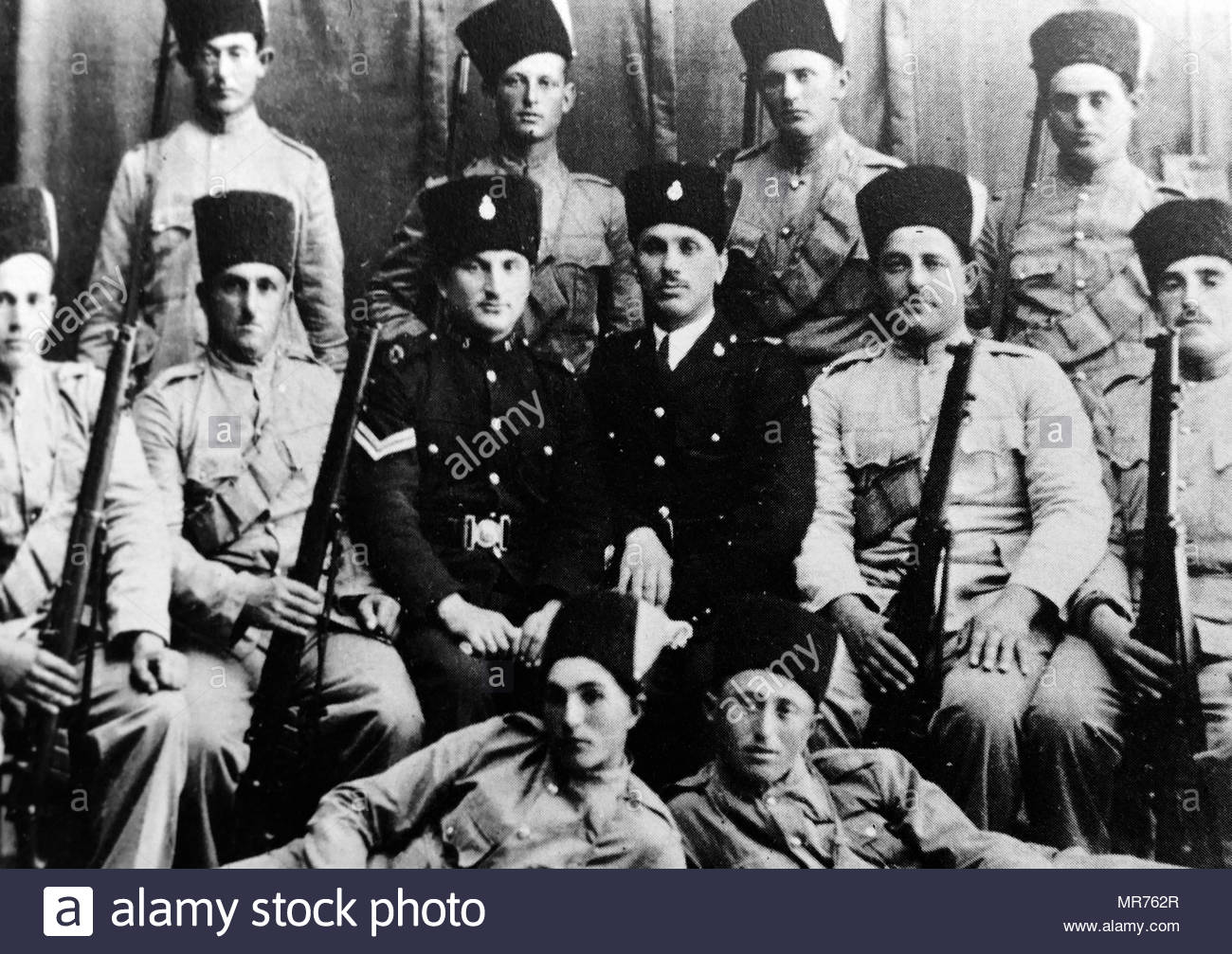 Yigal Allon (back row third from right) in a group of Jewish Settlement Police (JSP), a division of the Notrim established in Mandatory Palestine in 1936, during the 1936-39 Arab revolt. Yigal Allon (1918 – 1980) was an Israeli politician, a commander of the Palmas, and a general in the IDF. He served as one of the leaders of Ahdut HaAvoda party and the Israeli Labour party, and acting Prime Minister of Israel. - Stock Image