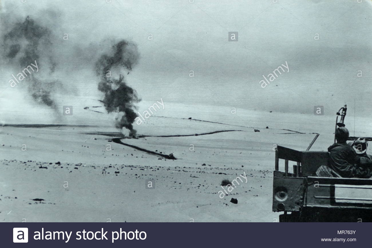 Israeli forces advance as Egyptian army tanks are destroyed in action in the Sinai Peninsula during the Six Day War 1967 - Stock Image