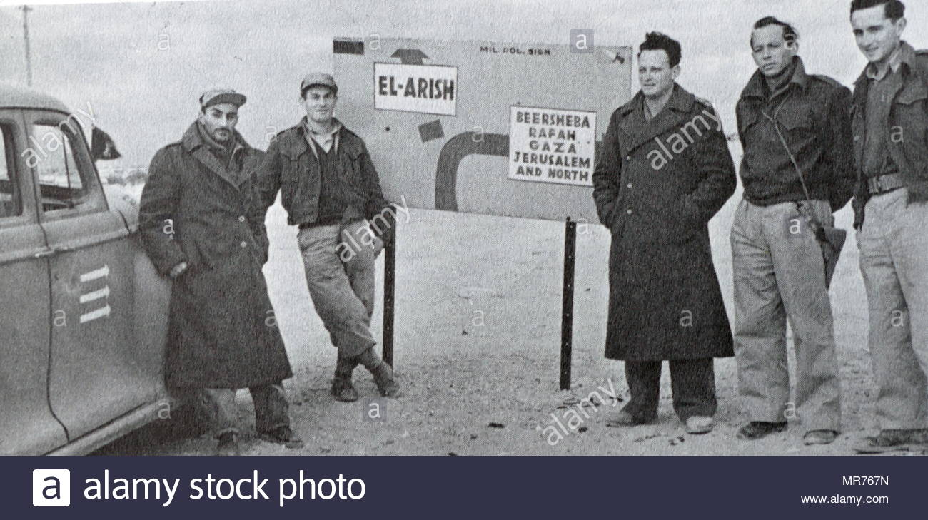 Yigal Allon (third from right) in a group of Israeli soldiers in Northern Negev during the Israeli War of Independence 1948. Yigal Allon (1918 – 1980) was an Israeli politician, a commander of the Palmach's, and a general in the IDF. He served as one of the leaders of Ahdut HaAvoda party and the Israeli Labour party, and acting Prime Minister of Israel. - Stock Image