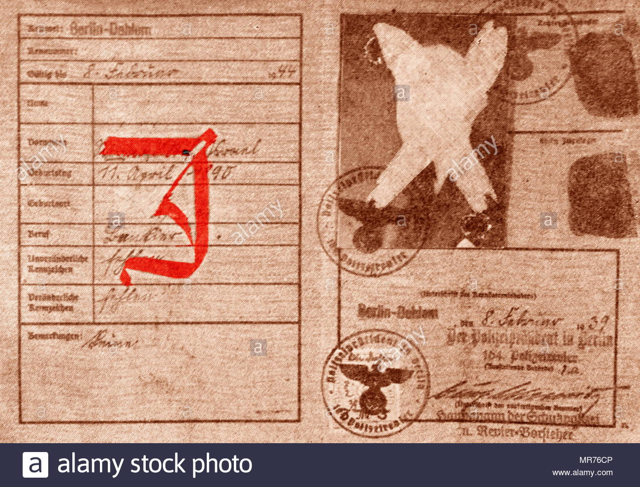 """A special identity card with a red """"J"""" stamped on it further advanced the exclusion of the Jews in 1939.  All Jewish people had to carry an identity card after the enactment of the Nuremberg Laws (Nürnberger Gesetze); anti-Semitic laws in Nazi Germany, introduced on 15 September 1935. - Stock Image"""