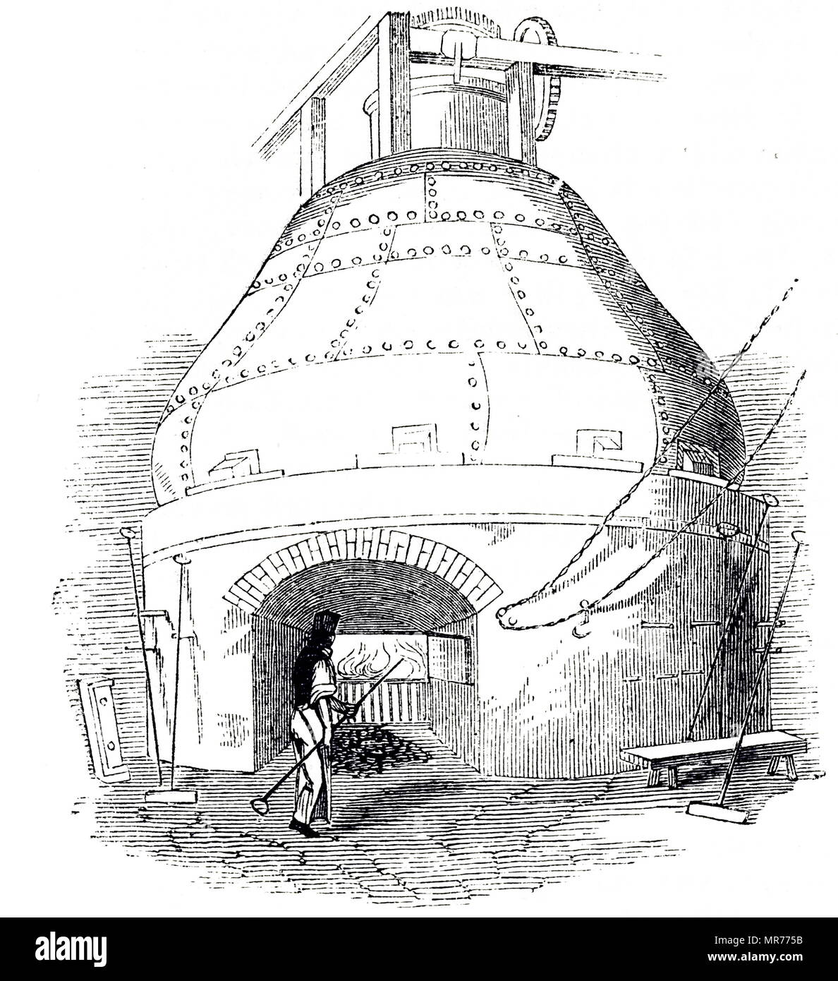 Engraving depicting a wash still containing about 20,000 gallons of mash, heated by a fire underneath. Dated 19th century - Stock Image
