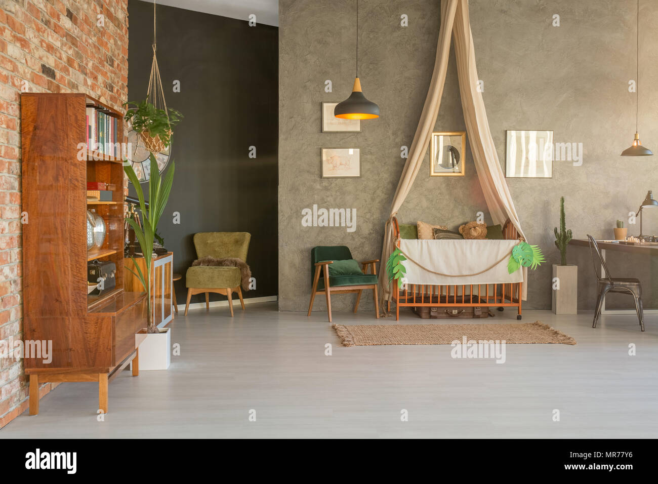 Spacious home interior with baby crib - Stock Image