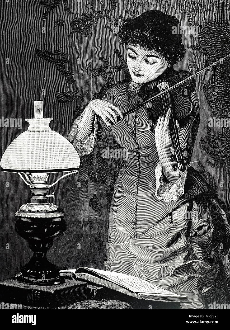 Engraving depicting a typical oil lamp fitted with an opaque glass shade to diffuse the light. Dated 19th century - Stock Image