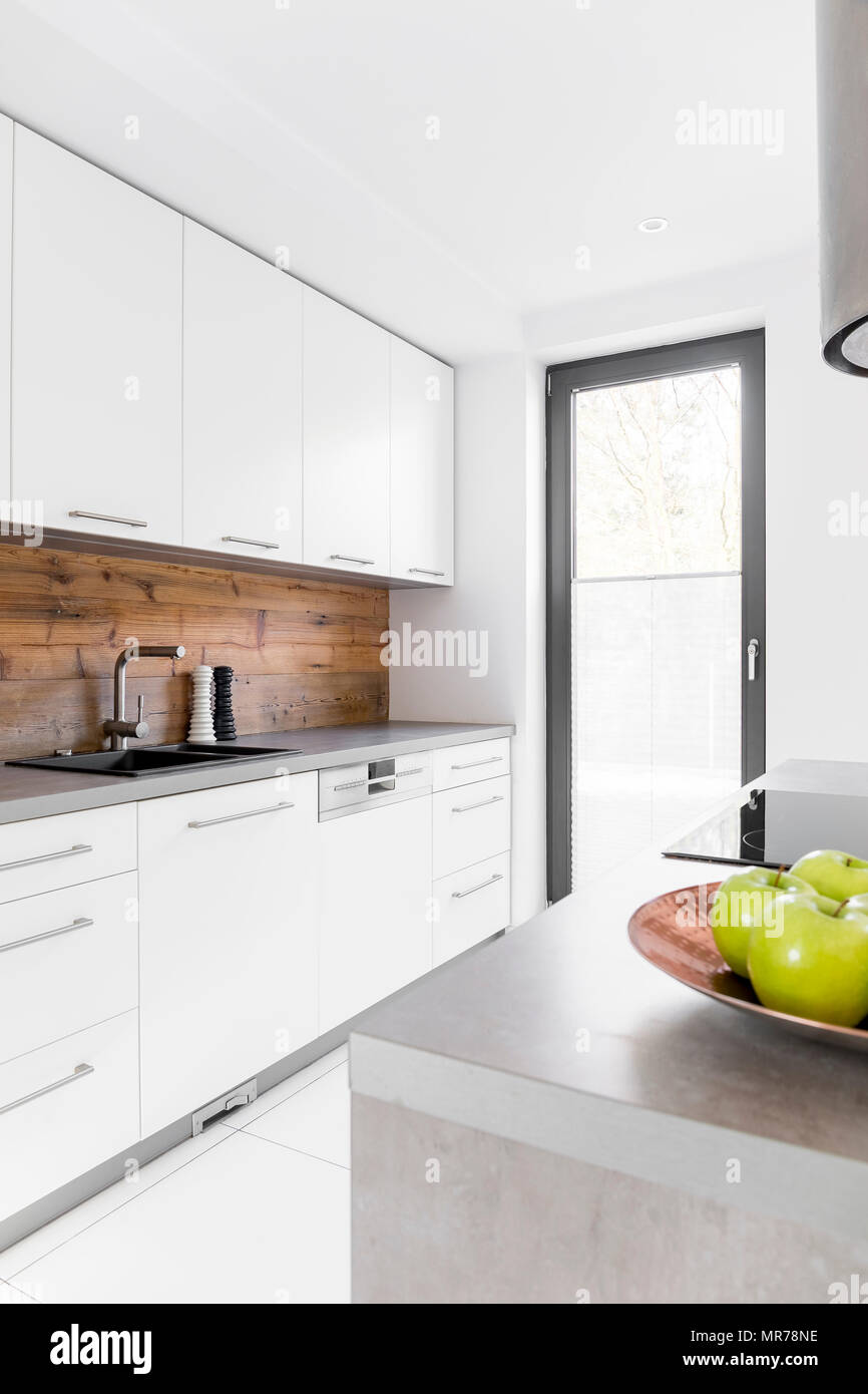 White kitchen with island in new luxury home Stock Photo