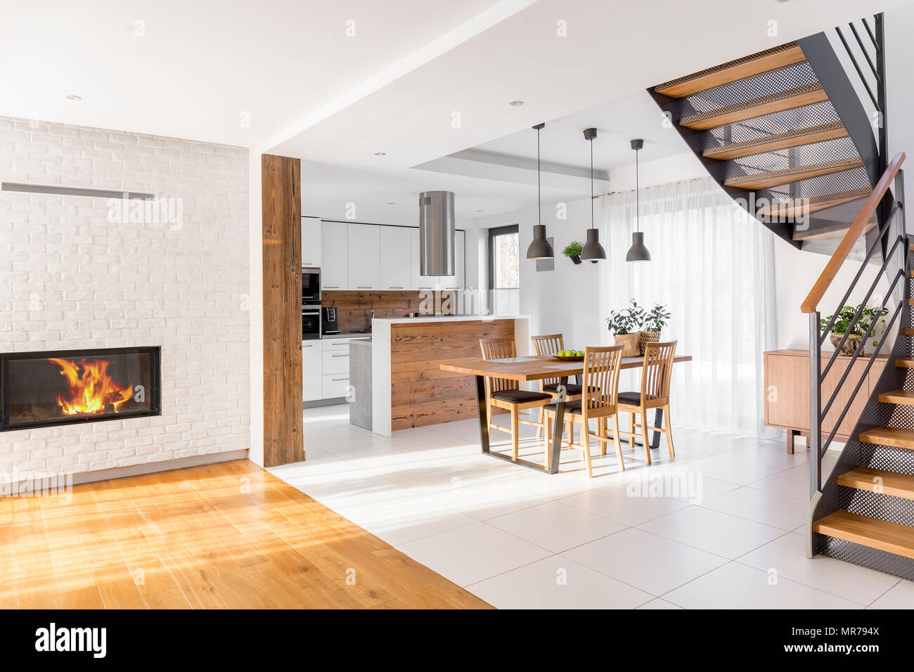 Modern luxury open plan apartment with stairs, communal table ...