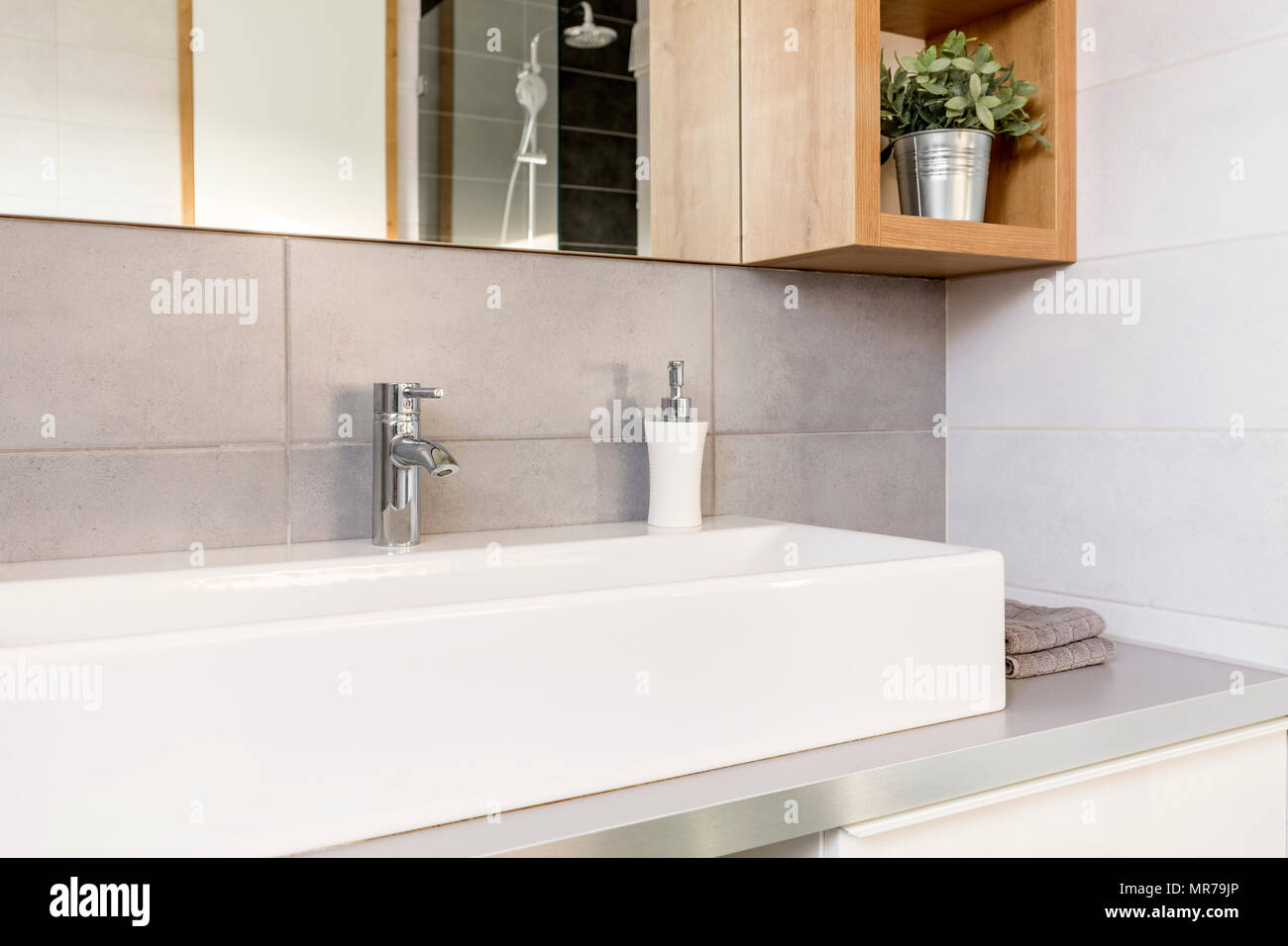 Grey and white bathroom with countertop basin and mirror Stock Photo ...