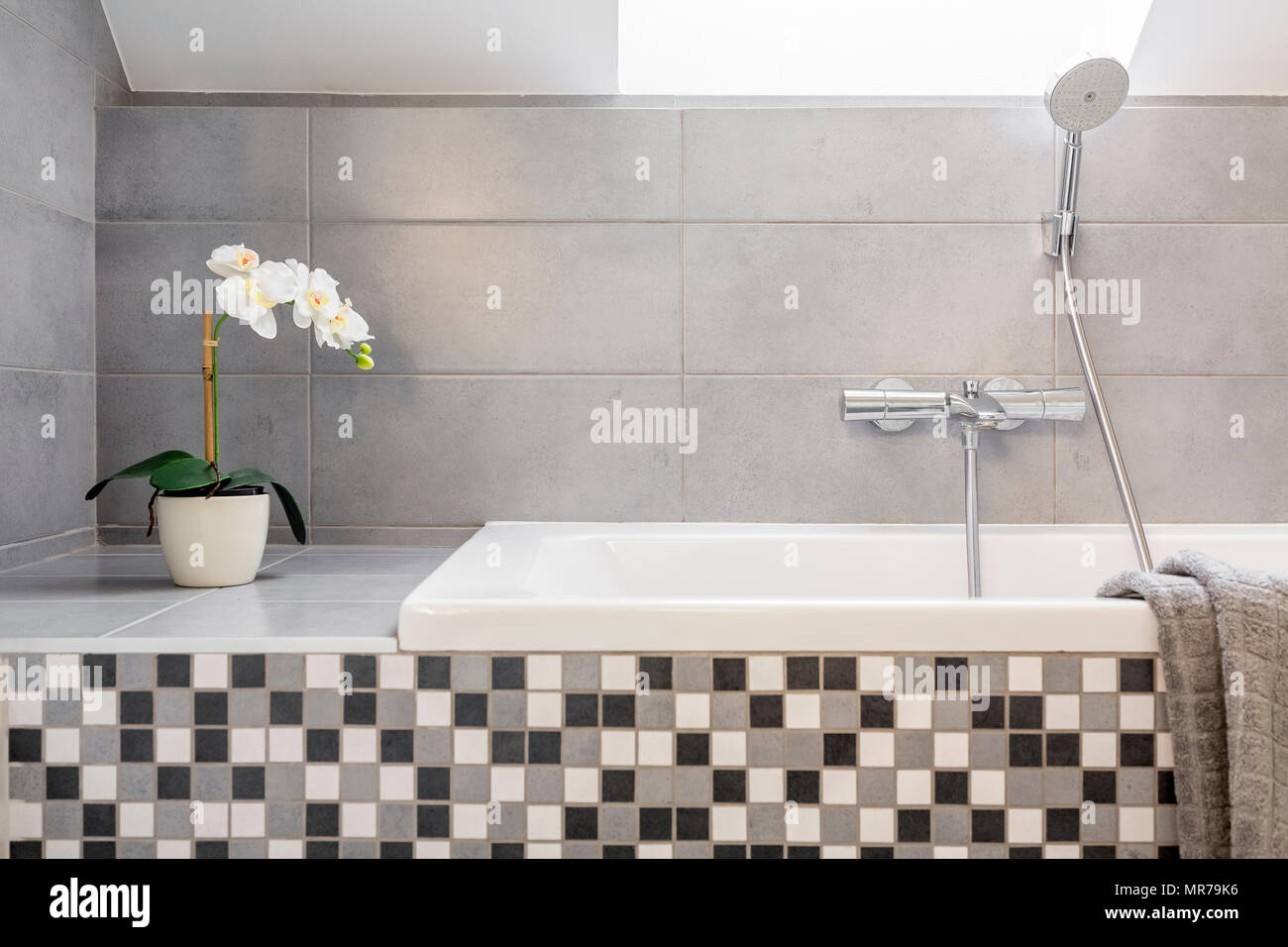Grey bathroom with mosaic tiles and bathtub Stock Photo: 186402026 ...
