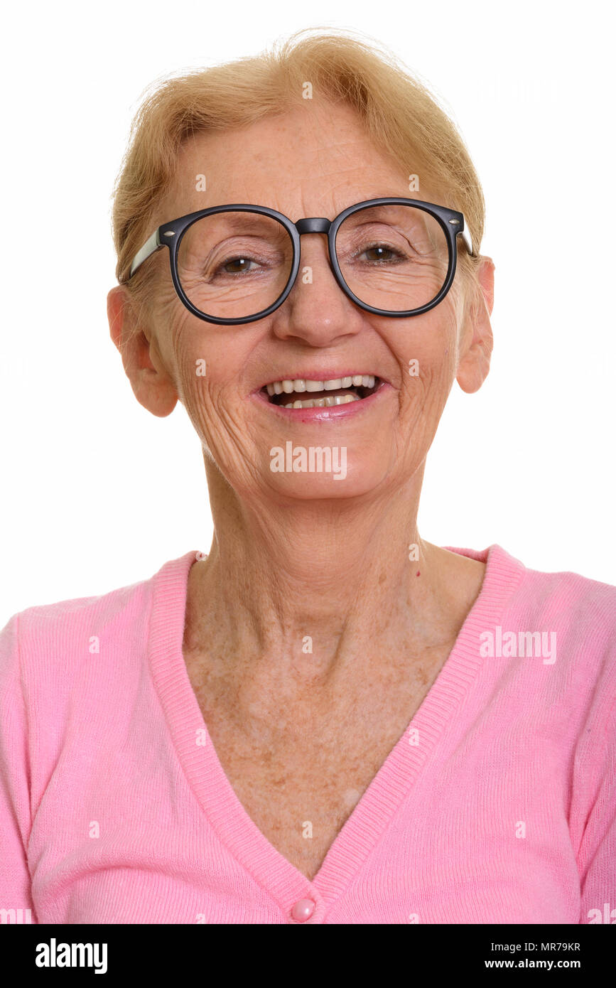 Face of happy senior nerd woman smiling while wearing geeky eyeg - Stock Image