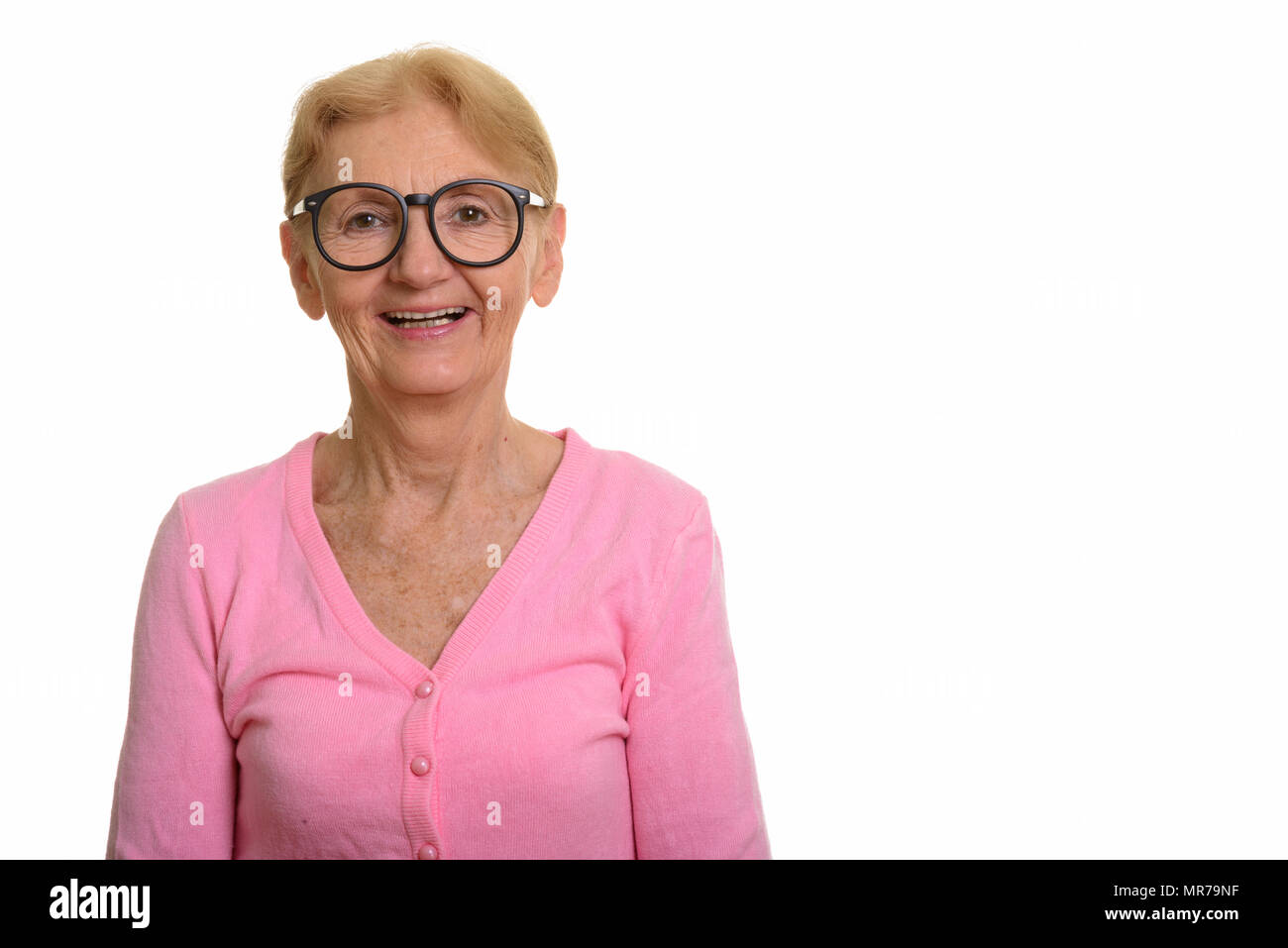 Happy senior nerd woman smiling and laughing while wearing geeky - Stock Image