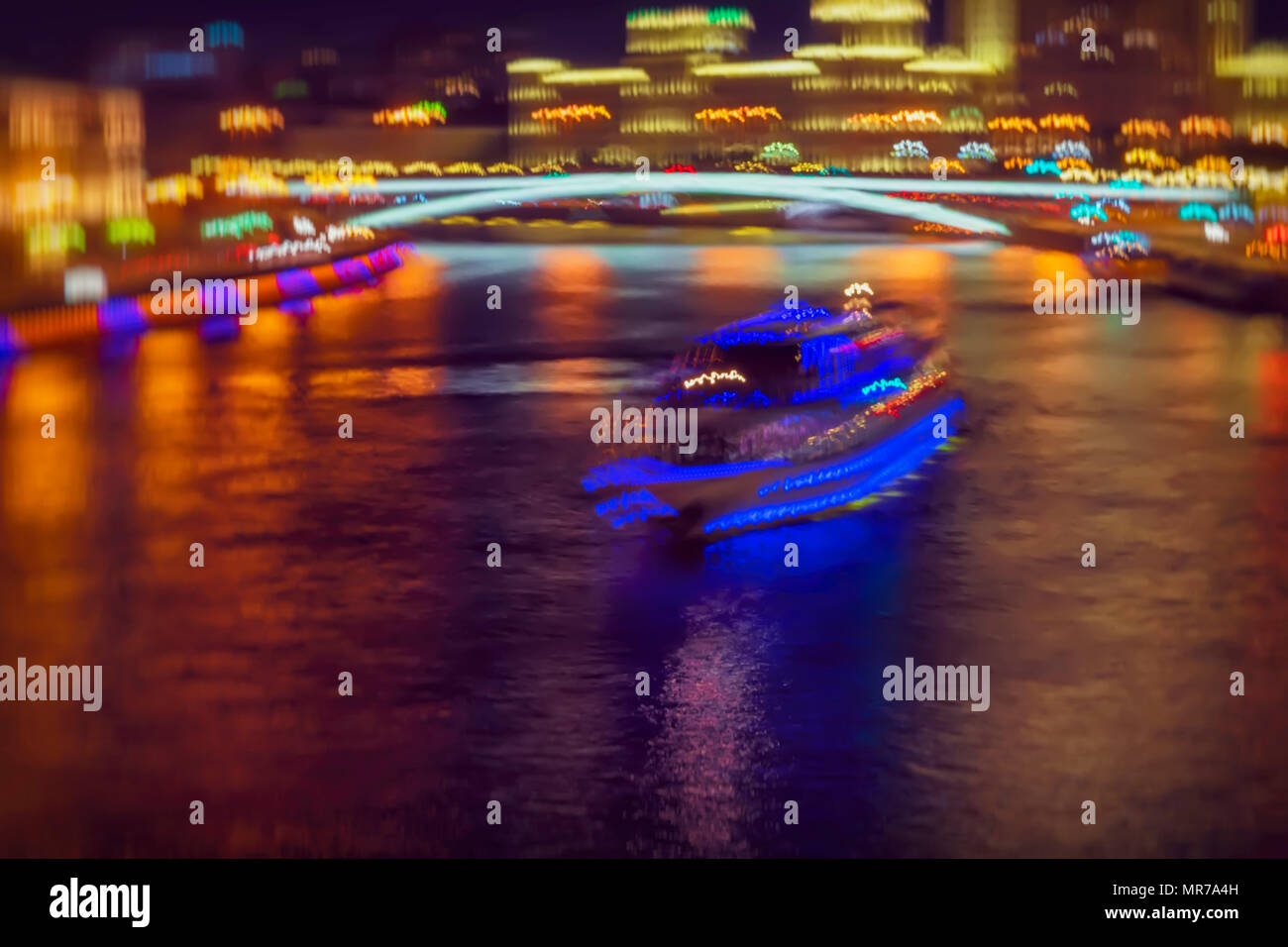 Bright blurred colorful abstract background of night city with ship for travels, excursions. Neon reflections on water - Stock Image