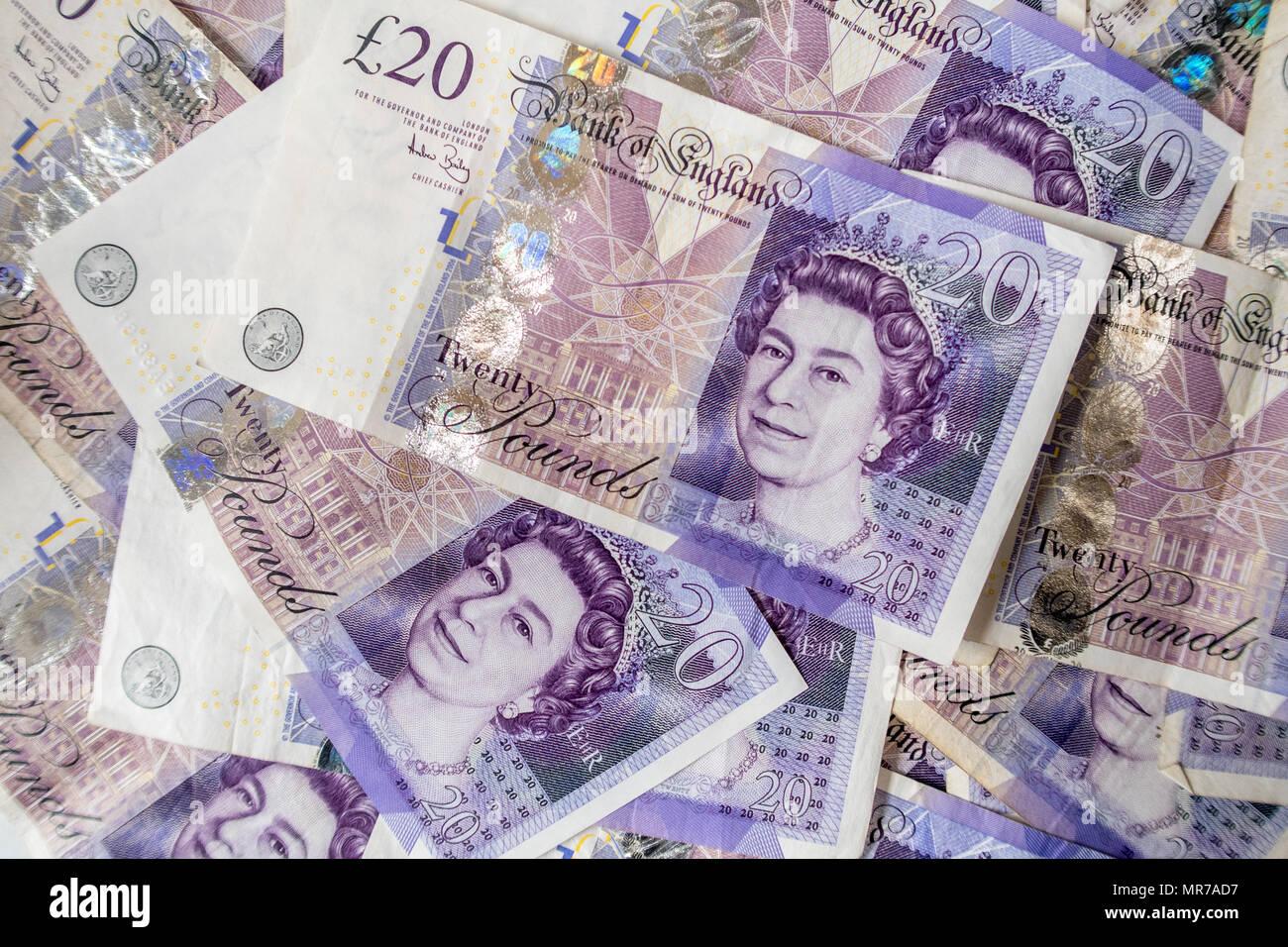 Background of a large pile of Twenty Pound bank notes - Stock Image