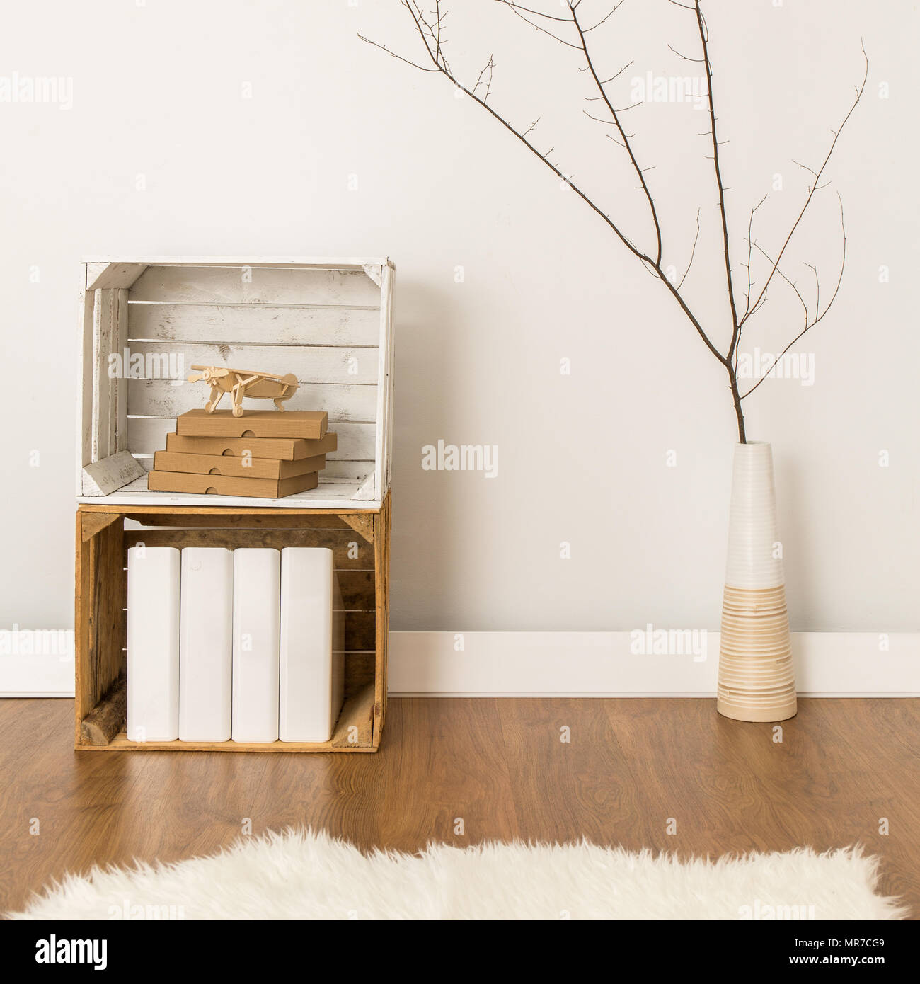 Handmade drawer and decor vase standing on wood floor. White wall in the background Stock Photo