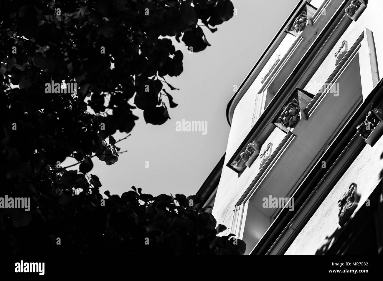 Old european apartment building view from below. black and white. - Stock Image
