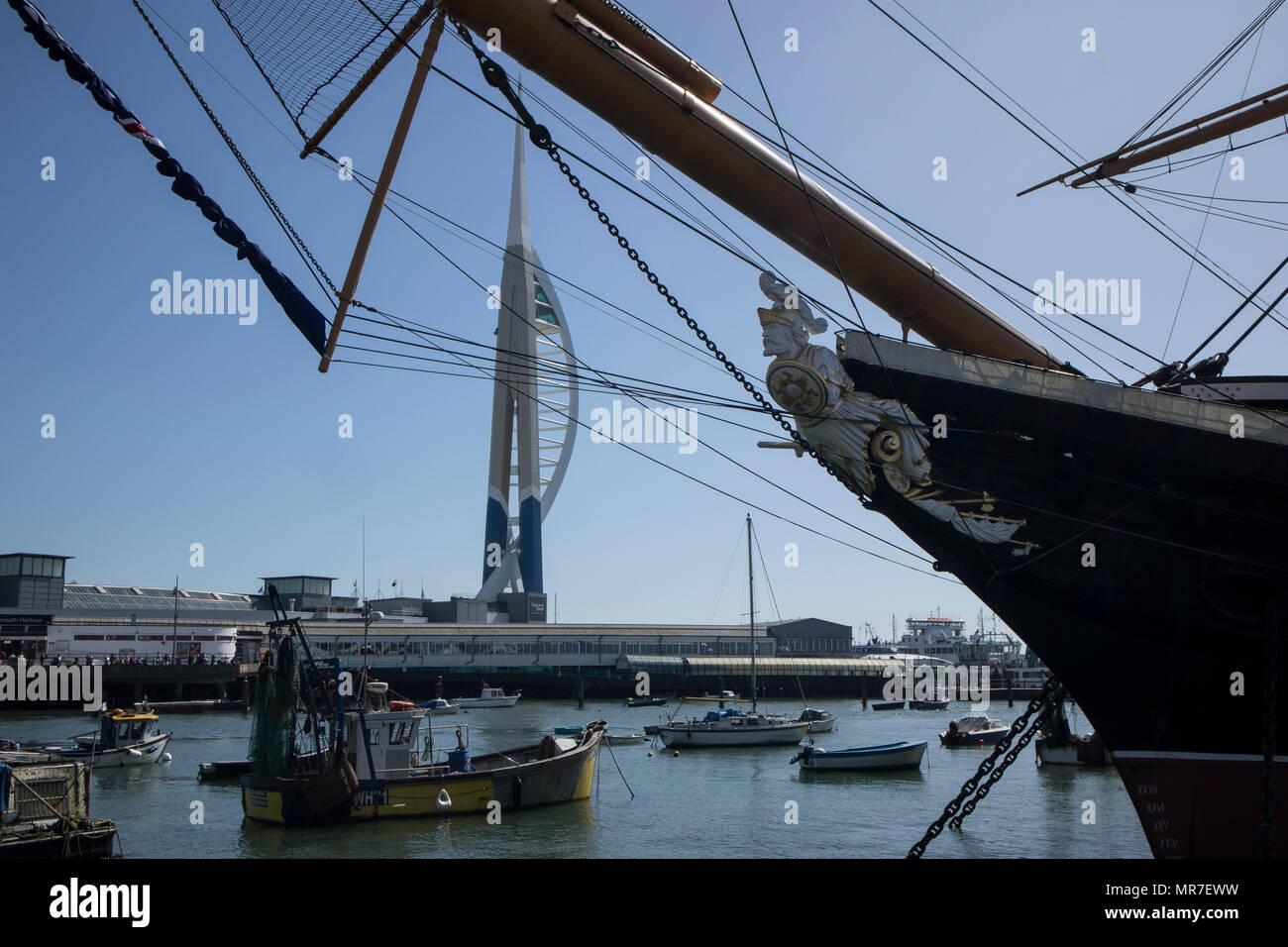 HMS Warrier in Portsmouth Historic Dockyards, UK, with the Emirates Spinnaker in the background Stock Photo