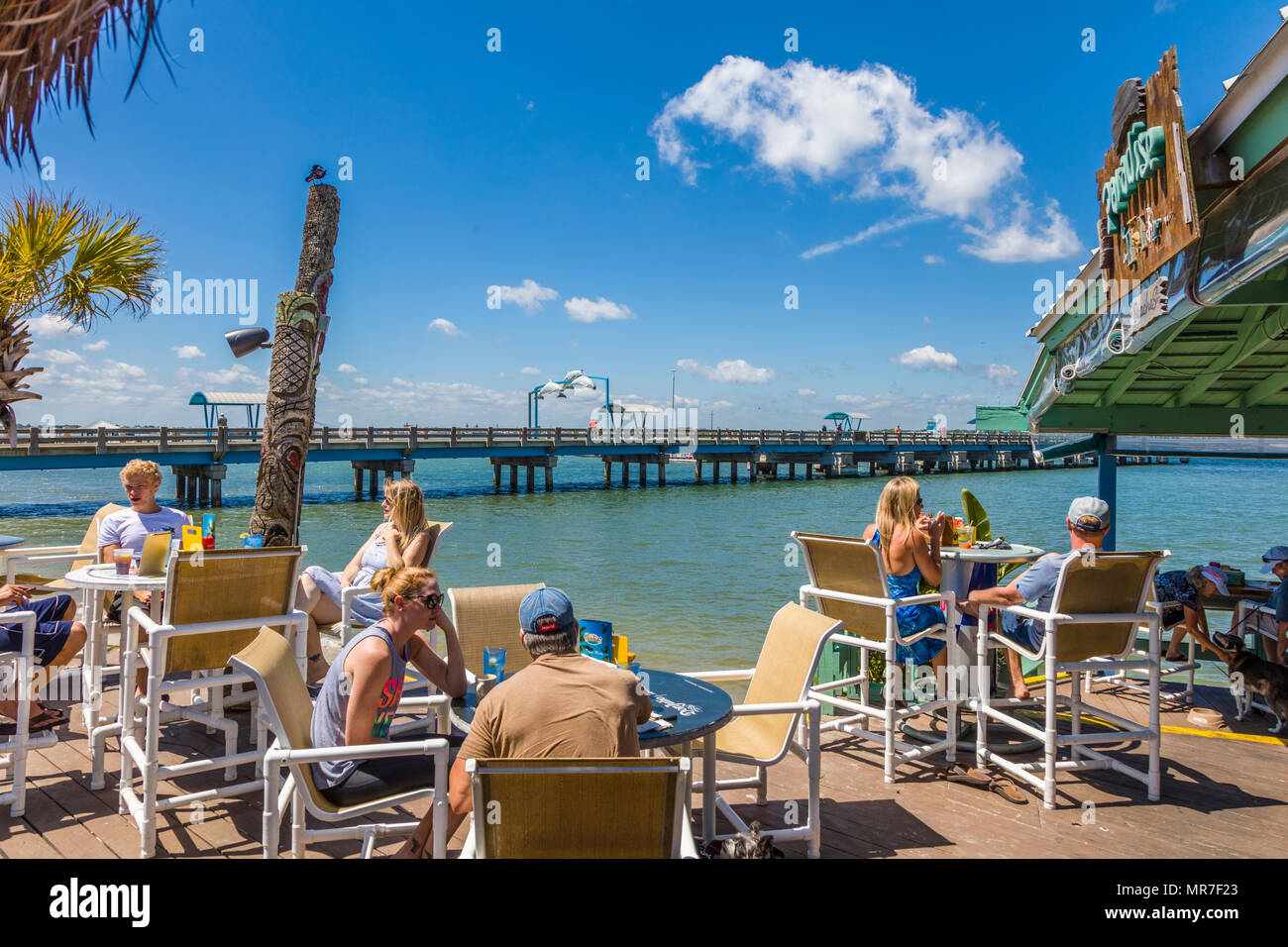 People enjoying summer day at Beaches at Vilano waterfront outdoor restaurant cafe in Vilano Beach near St Augustine Florida Stock Photo