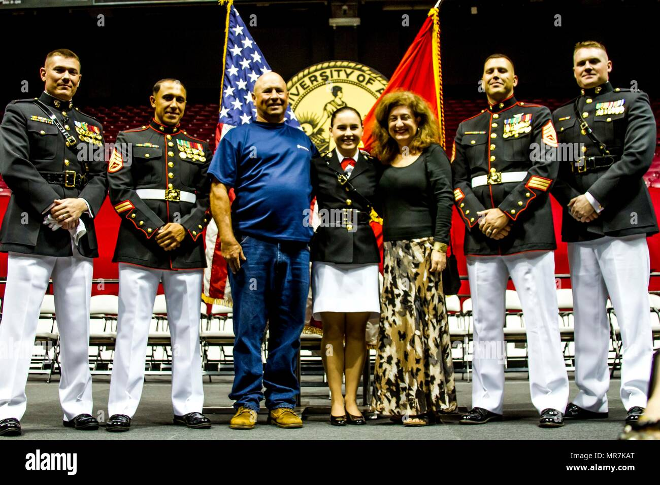 "Second Lieutenant Mary Sanders poses with Marines with the officer selection team for Recruiting Station Montgomery and family members after her commissioning ceremony at Coleman Coliseum, May 12, 2017. Sanders is a recent graduate of Alabama State University and attended Platoon Leaders Course and Officer Candidate School before being commissioned. ""After a couple of weeks I saw how the Marine Corps worked and was hooked. I was so inspired and motivated that if I had any doubts before, they were gone. This was something I wanted to be a part of."" (U.S. Marine Corps photo by Cpl. Krista James/ - Stock Image"