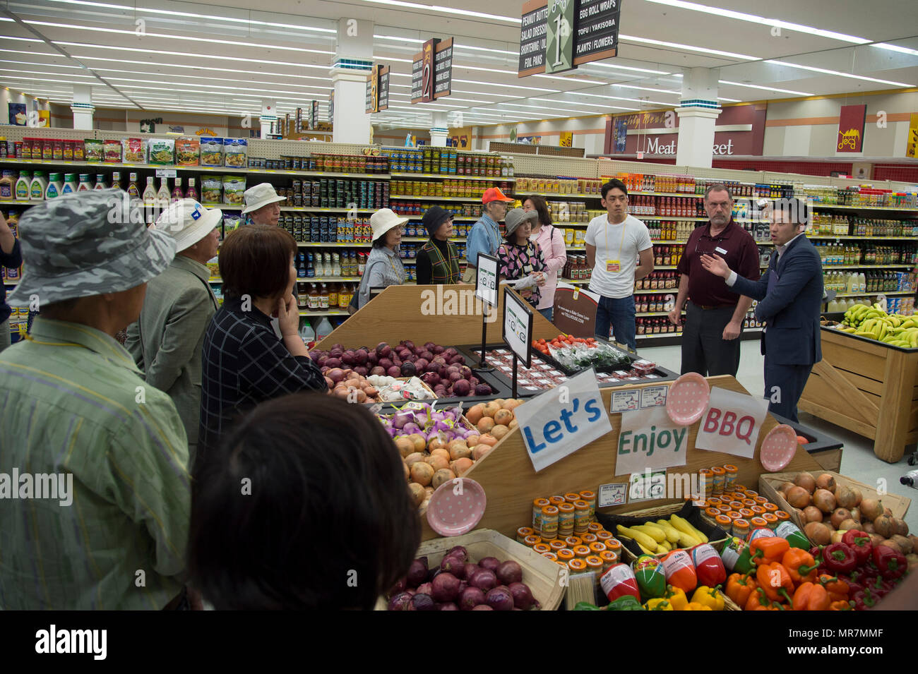 Japanese locals tour the Commissary during the monthly tour of Misawa Air Base, Japan, May, 19, 2017. Guests receive a 30-minute brief at a specific local each month to learn more about the mission of Misawa AB while learning more about the installation's friendship and community engagement with the city and surrounding areas. In addition to these specialized briefs, they tour the base perimeter, highlighting important locations on the base. This week, 30 community members coming from as far as Hirosaki, Japan, joined the tour. (U.S. Air Force photo by Senior Airman Deana Heitzman) - Stock Image