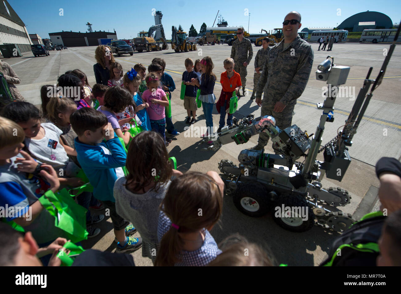U.S. Air Force Staff Sgt. Brook Hamilton, 52nd Civil Engineer Squadron explosive ordnance disposal team member, shows children from Spangdahlem Elementary School an EOD robot during Children's Deployment Days at Spangdahlem Air Base, Germany, May 22, 2017. The event helped children better understand a deployment and included a pre-deployment brief, individual protective equipment station and multiple static displays for children to learn about. (U.S. Air Force photo by Airman 1st Class Preston Cherry) - Stock Image