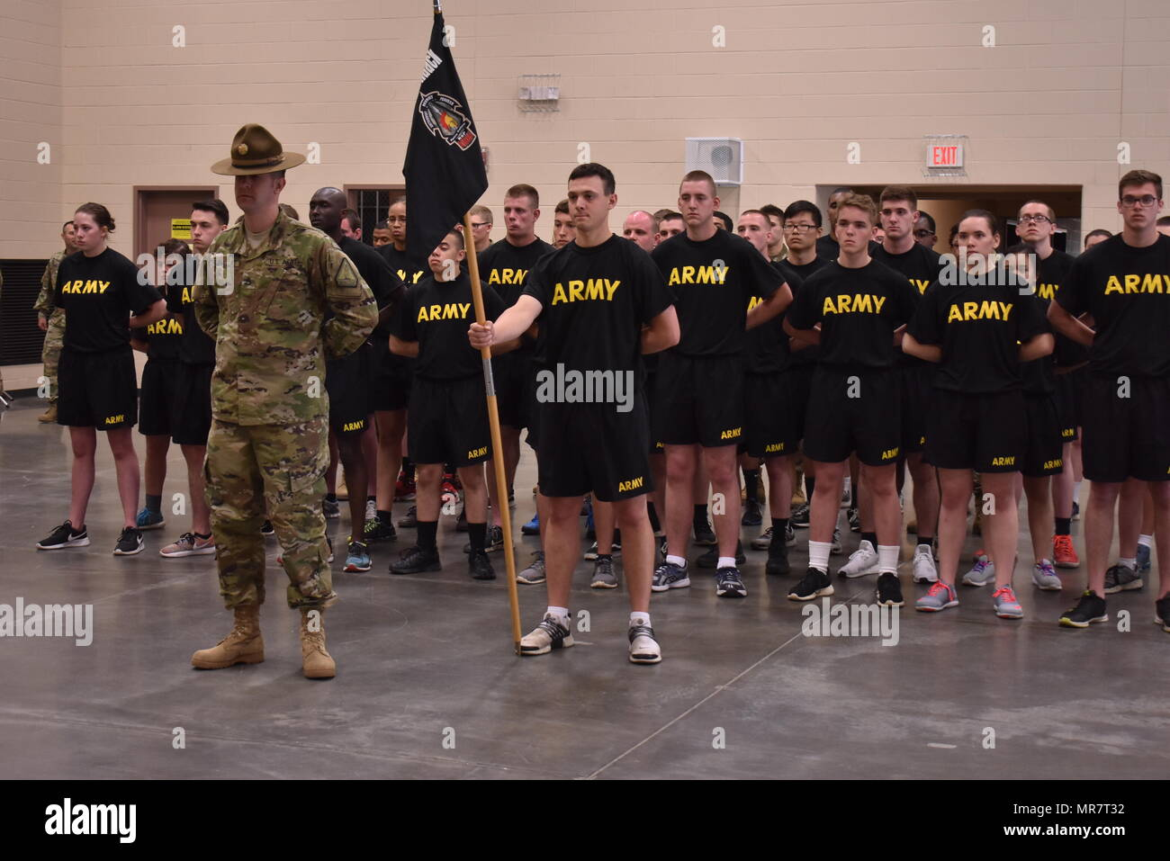 U.S. Army National Guard soldiers from Bravo Company, Recruiting and Retention Command, stand in formation in the Queensbury Armory, Queensbury N.Y., May 21, 2017. Soldiers were waiting for family and friends to arrive for the Recruit Sustainment Program graduation and Battle Handoff ceremony. (U.S. Army National Guard photo by Pfc. Andrew Valenza) - Stock Image