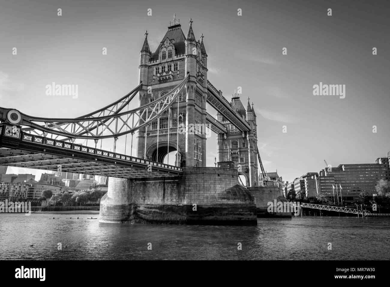 This is a black and white photo of Tower Bridge one of Londons Iconic land marks - Stock Image