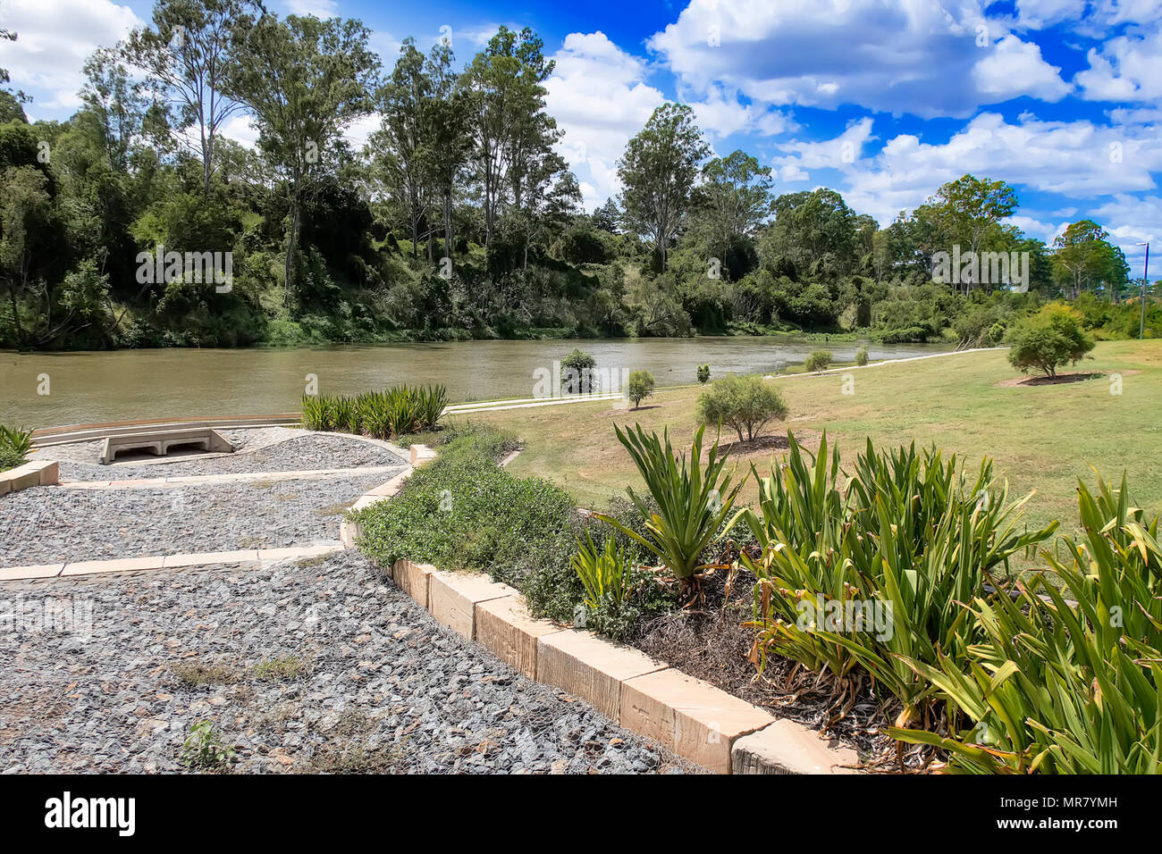 The park at Colleges Crossing is drained through the gravel and under the pathway to the river - Stock Image