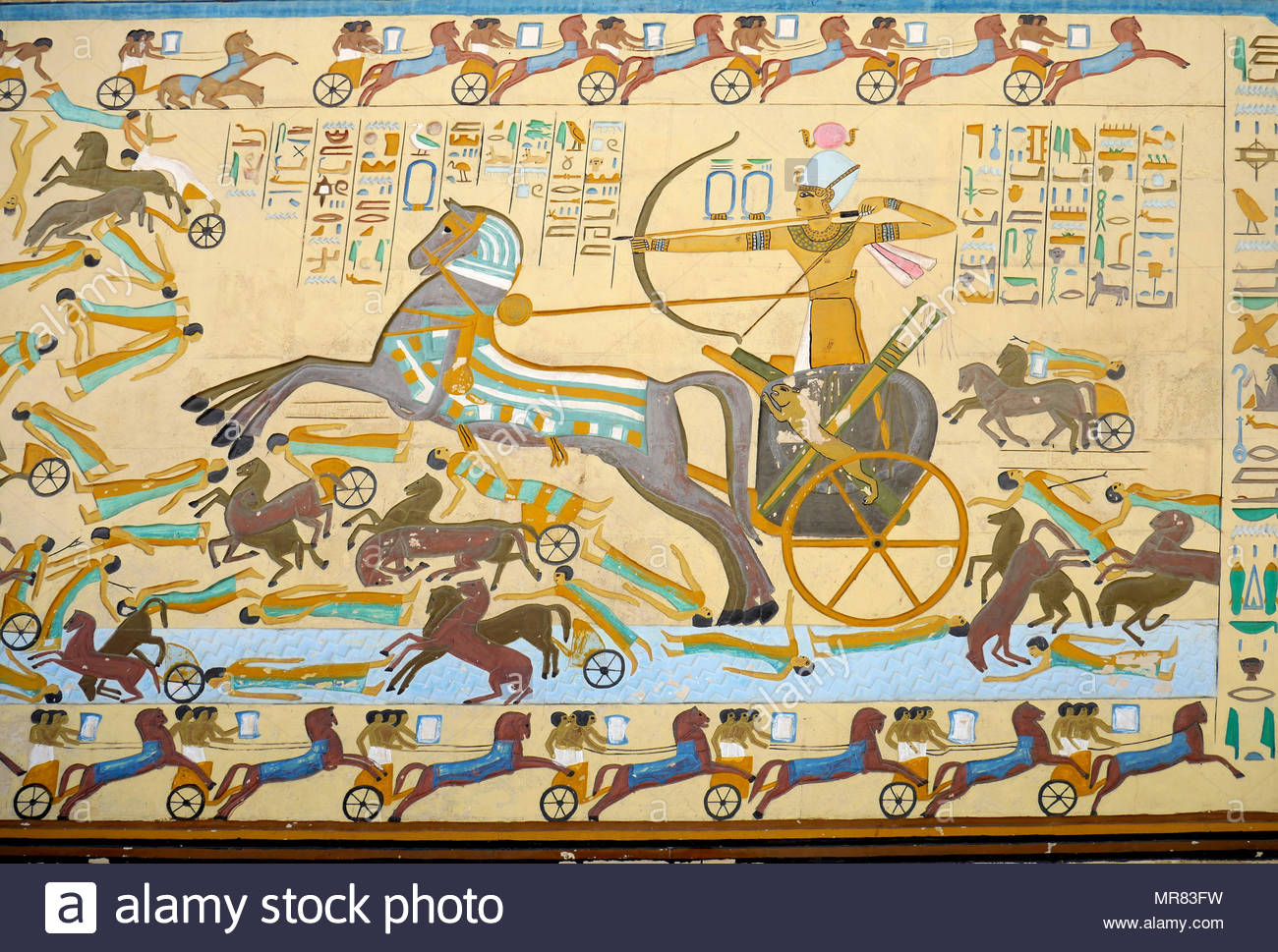 Reconstruction of a painted fresco depicting a battle scene in ancient Egypt. A Pharaoh defeats his enemies in a massive chariot led onslaught. The Battle of Kadesh or Battle of Qadesh took place between the forces of the Egyptian Empire under Ramesses II and the Hittite Empire under Muwatalli II at the city of Kadesh on the Orontes River, just upstream of Lake Homs near the modern Syrian-Lebanese border. The battle is generally dated to 1274 BC in the conventional Egyptian chronology, and is the earliest battle in recorded history for which details of tactics and formations are known. It is b - Stock Image