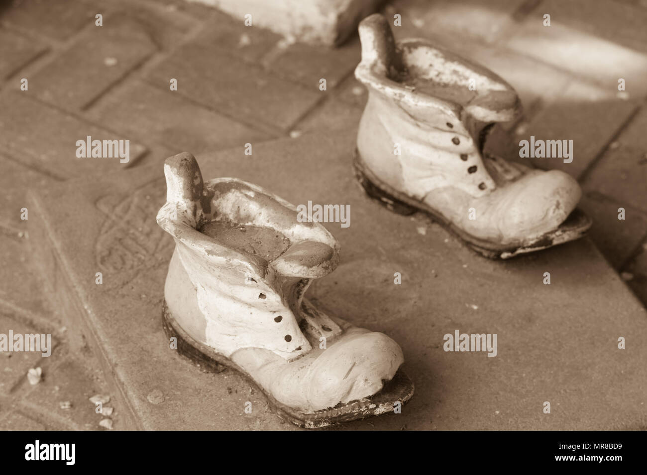 statue of leaky boots - Stock Image