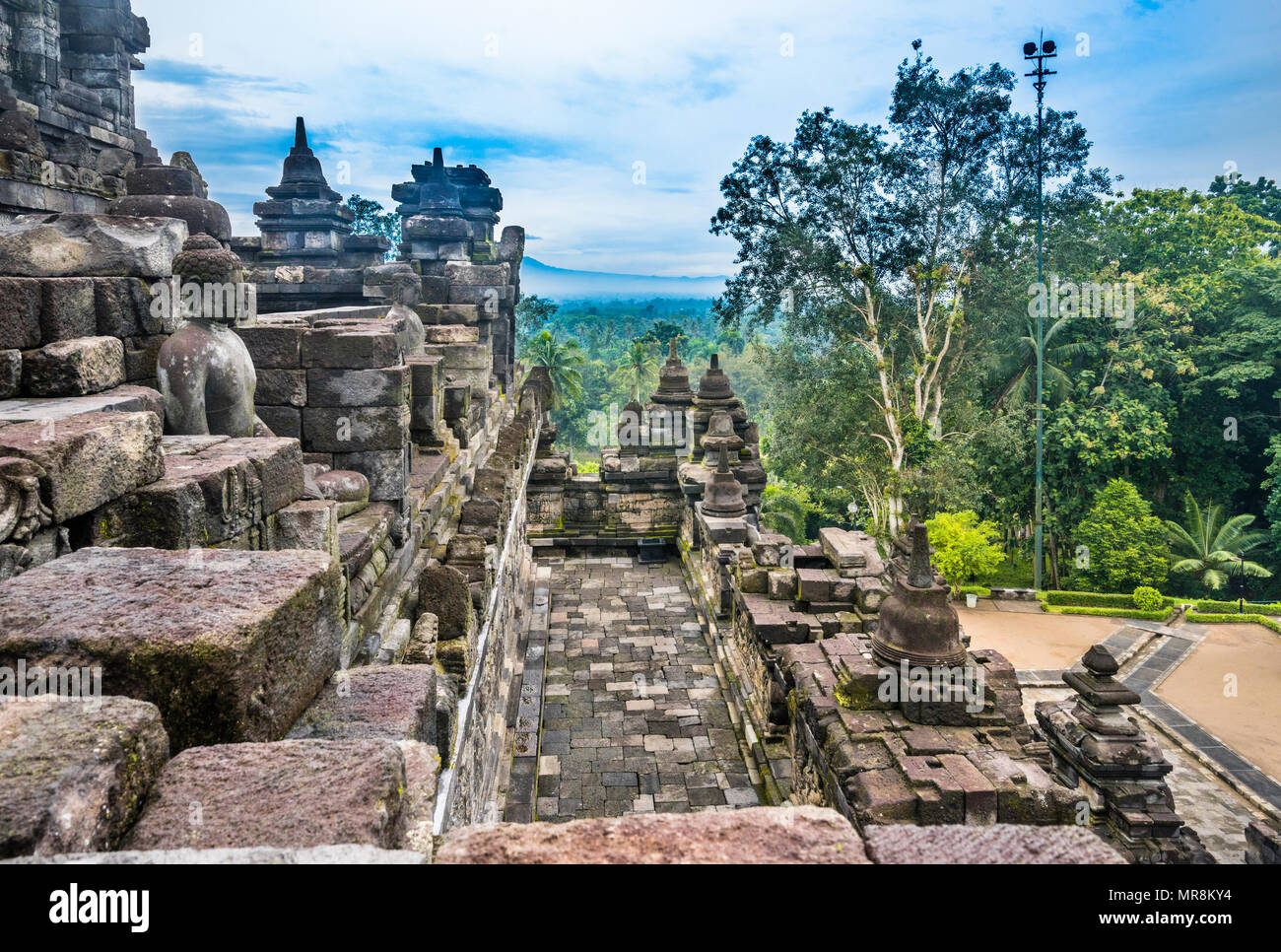 stone masonry corridor and balustrades of a lower platform at the 9th century Borobudur Buddhist temple, Central Java, Indonesia - Stock Image