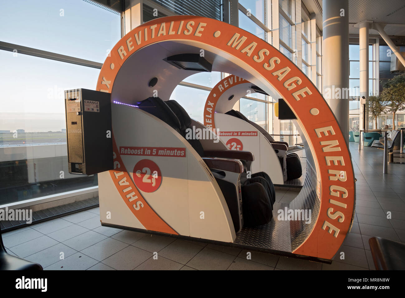 A machine at Airport Schiphol outside of Amsterdam, Netherlands  that offers a 5 minute revitalizing massage for two Euros. - Stock Image
