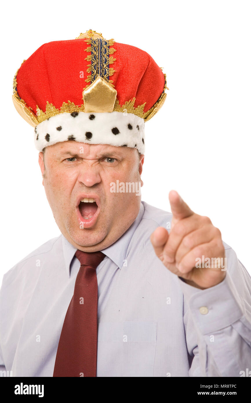 A business leader with a crown, barking orders. - Stock Image