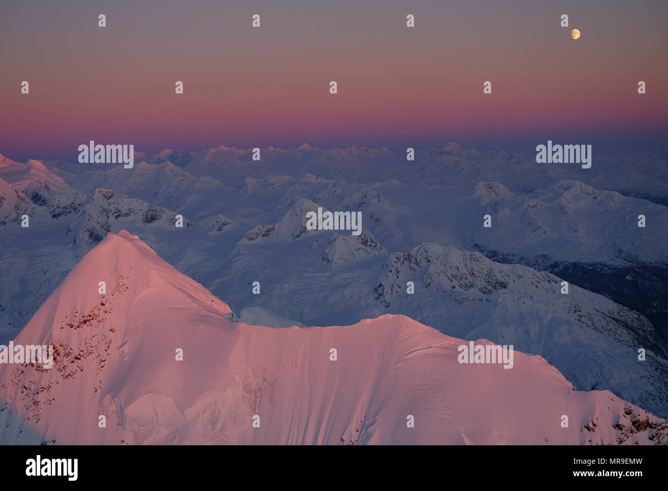 Moonrise over Peak 7368, Chugach Mountains, Alaska - Stock Image
