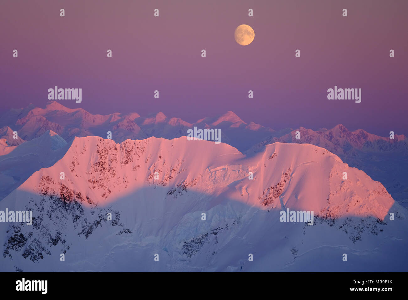 Moonrise over the Chugach Mountains, Alaska - Stock Image