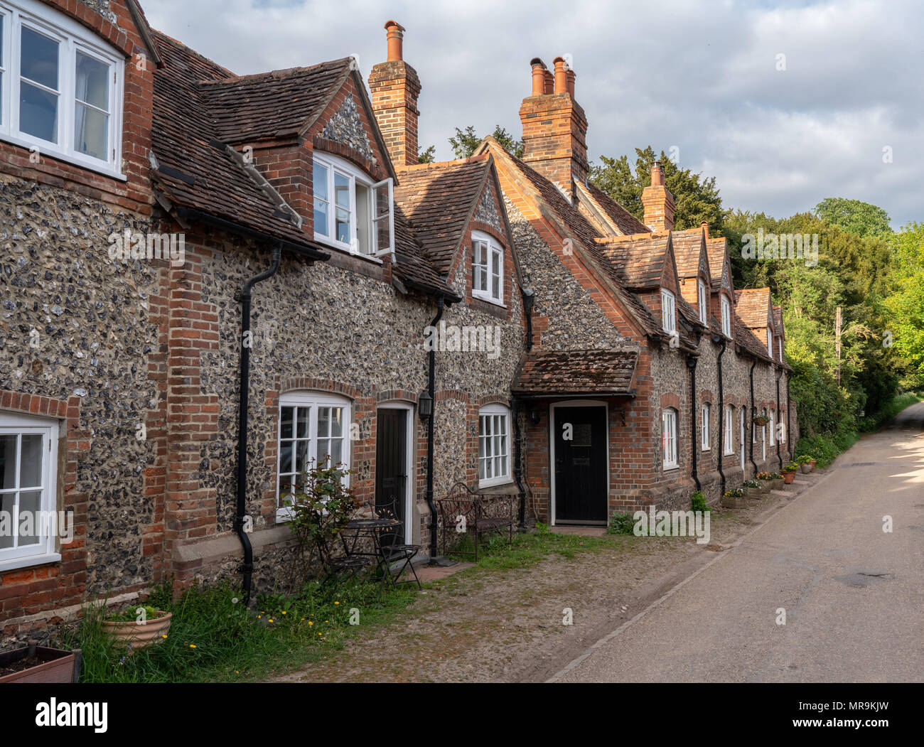 Pretty street of brick houses in village of Hambleden - Stock Image