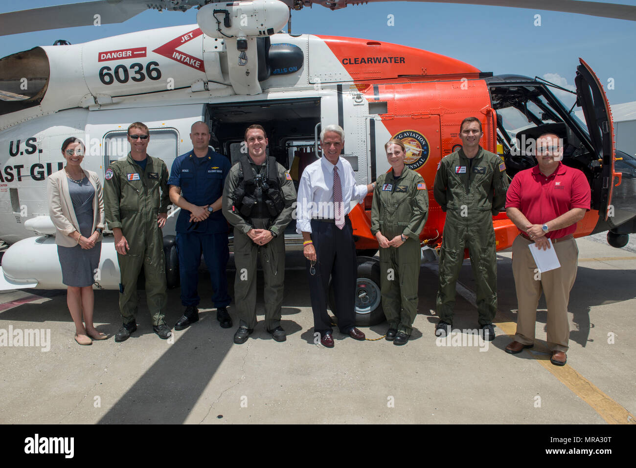 Congressman Charlie Crist, U.S. Representative for Florida's 13th District, center, meets with Air Station Clearwater crew members for a group photo Tuesday, May 30, 2017, prior to an aerial assessment of beach erosion along Pinellas County, Florida's coast. Coast Guard Air Station Clearwater MH-60 Jayhawk helicopter crew members provided the overflight for the congressman and Army Corps of Engineers personnel. U.S. Coast Guard by Petty Officer 1st Class Michael De Nyse - Stock Image