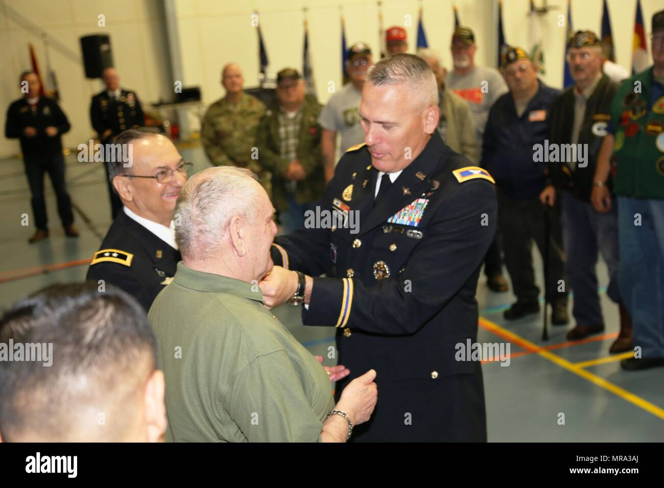 Fort McCoy Garrison Commander Col. David J. Pinter Sr. places a Vietnam Veterans Lapel Pin on retired Command Sgt. Maj. Kenneth Stumpf, a Medal of Honor recipient, during the Vietnam Veterans Welcome Home Ceremony on May 20, 2017, at Fort McCoy, Wis. Each veteran attending the ceremony received a Vietnam Veterans Lapel Pin. The ceremony was one of many taking place around the United States that officially recognizes veterans who served between May 1, 1955, and Nov. 15, 1975. The ceremony also was held in conjunction with the 2017 Fort McCoy Armed Forces Day Open House. (U.S. Army Photo by Scot Stock Photo