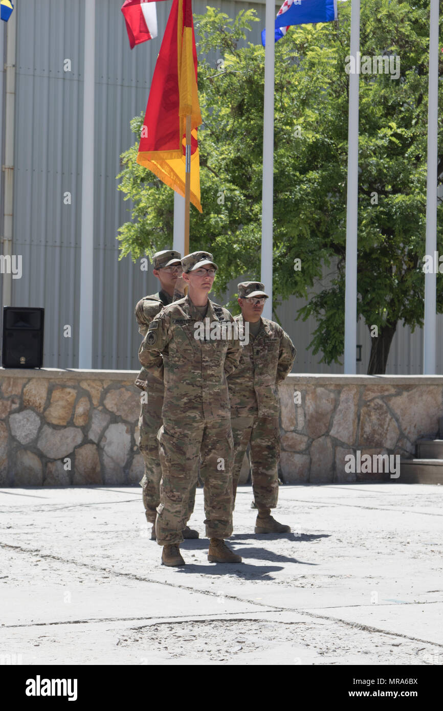 The Special Troops Battalion, 1st Armored Division Resolute Support Sustainment Brigade, held a transfer of authority and uncased their colors at Bagram Air Field, Afghanistan May 29. The TOA and uncasing of the colors symbolizes the official beginning of their mission. - Stock Image