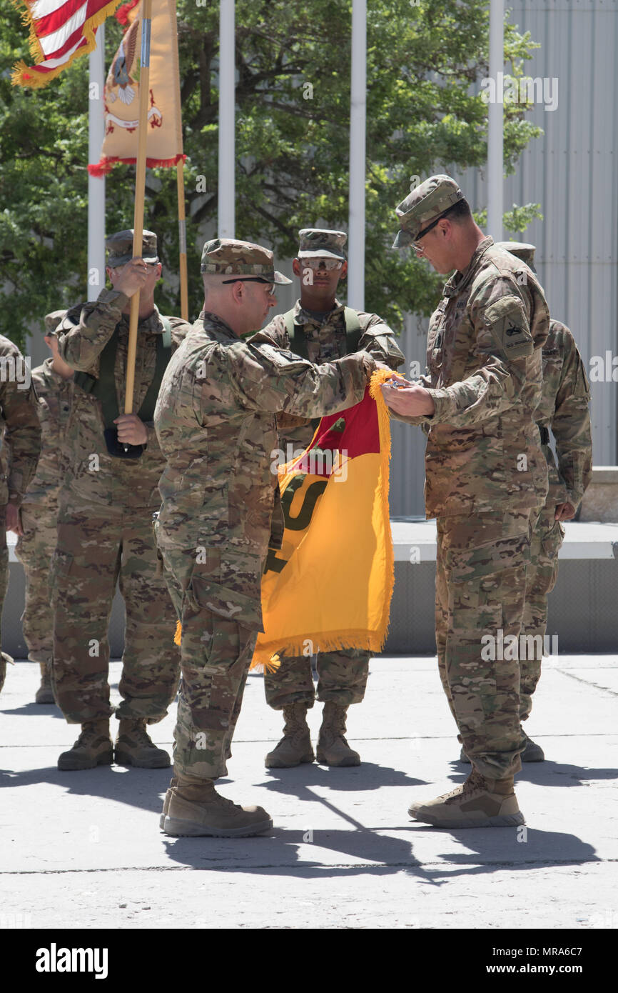 """The 1st Armored Division Resolute Support Sustainment Brigade, """"TF Muleskinners,"""" held a transfer of authority and uncased their colors at Bagram Air Field, Afghanistan May 29. The TOA and uncasing of the colors symbolizes the official beginning of their mission. - Stock Image"""