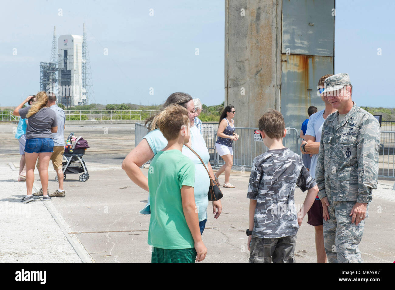 Brig. Gen. Wayne Monteith, 45th Space Wing commander, speaks with Airmen and their family members at the Apollo 1 pad during the 2017 Cape Family Day, April, 29, 2017, at Cape Canaveral Air Force Station, Fla. The tour route concluded at the Apollo 1 pad at Launch Complex 34 where visitors were able to tour the site of the tragedy, which claimed the lives of three American astronauts. (U.S. Air Force photo by Phil Sunkel) - Stock Image