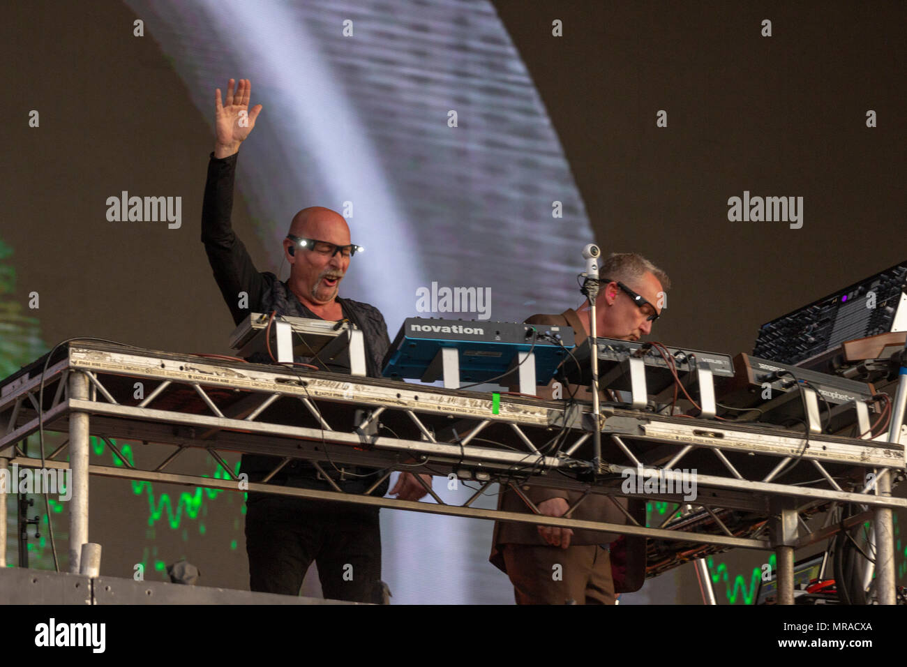 London, UK , 25 May 2018. Orbital are an English electronic dance music duo from Sevenoaks, Kent, England consisting of brothers Phil and Paul Hartnoll. The band's name is taken from Greater London's orbital motorway, the M25, which was central to the early rave scene and party network in the South East during the early days of acid house. In addition, the cover art on three of their albums shows stylised atomic orbitals. Credit: Darron Mark/Alamy Live News - Stock Image