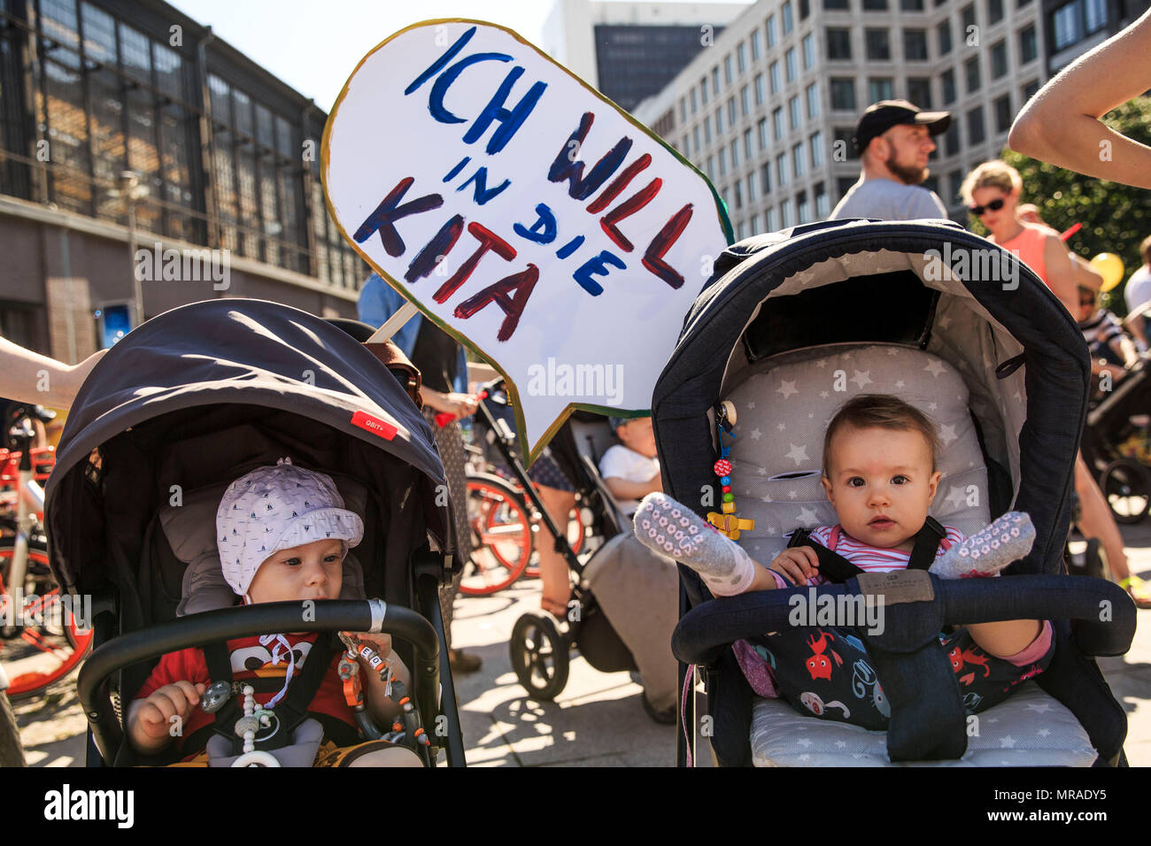 Berlin, Germany, 26 May 2018, Babies with a 'Ich will in die Kita' (lit. 'I want to go to daycare') sign are at a protest. Parents and educators demand more daycare places to be available for their children and better pay for daycare workers. According to Berlin's Family Office, 170 000 daycare places are currently available. Despite the steady increase in recent years, 2500 children are still without a daycare spot. Photo: Carsten Koall/dpa Credit: dpa picture alliance/Alamy Live News Stock Photo