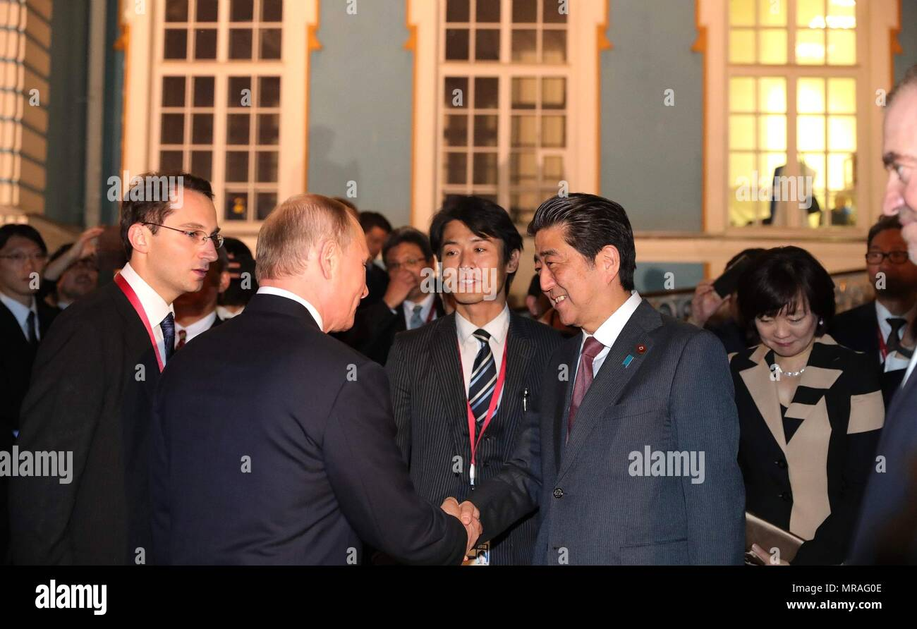 St. Petersburg, Russia, 25 May 2018. Russian President Vladimir Putin, left, greets Japanese Prime Minister Shinzo Abe, right, at the Stars of the White Nights Gala at Tsarskoe Selo May 25, 2018 outside St. Petersburg, Russia.  The Stars of the White Nights is an annual ballet, opera and classical music festival.   (Russian Presidency via Planetpix) Credit: Planetpix/Alamy Live News - Stock Image