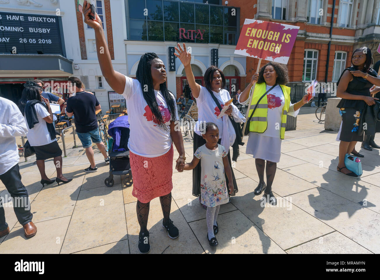 London, UK  26th May, 2018  People rasied their hands as the choir
