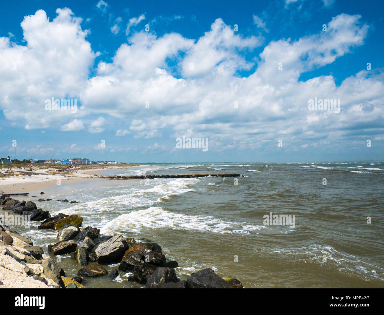 OCEAN CITY - MAY 24: View of the seashore with beachfront hotels in the background in Ocean City, MD on May 24, 2014. Ocean City, MD is a popular beac - Stock Image