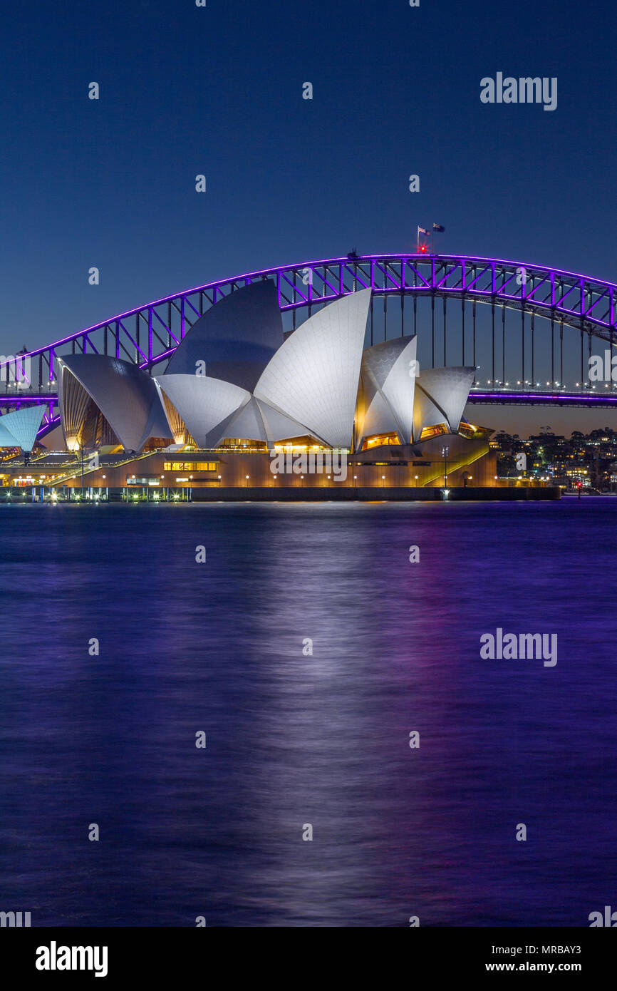 Sydney Harbour Bridge and Sydney Opera House during the 2018 'Vivid Sydney' festival, which sees special lighting effects displayed on notable landmar Stock Photo