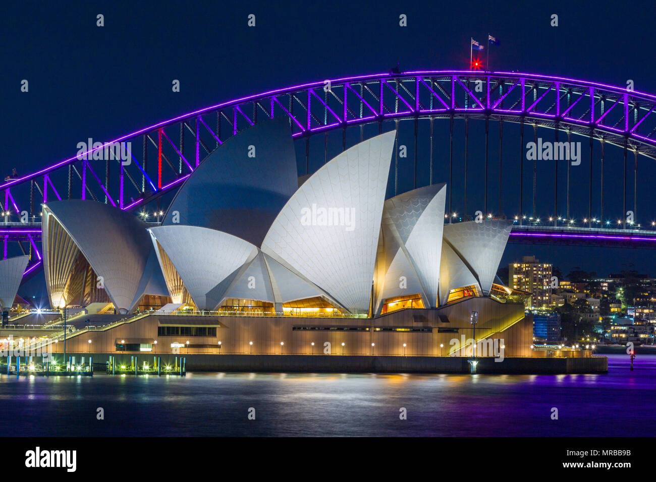 Sydney Harbour Bridge and Sydney Opera House during the 2018 'Vivid Sydney' festival, which sees special lighting effects displayed on notable landmar - Stock Image