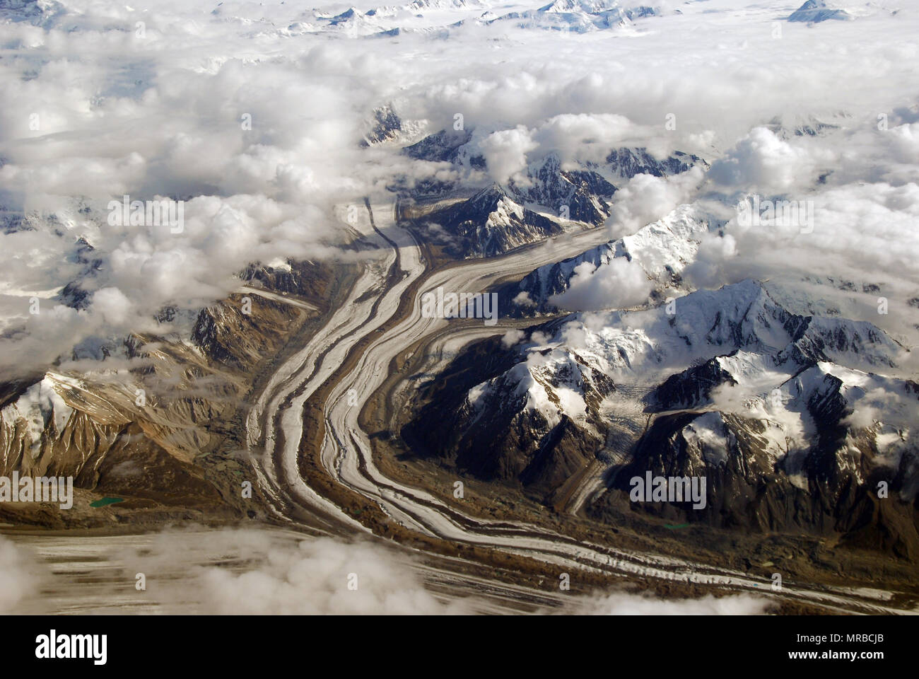 The Chugach mountains in Alaska with summer snow and clouds - Stock Image
